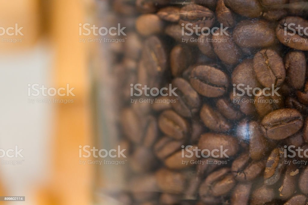 coffee bean, stored in glass bottle, in a cafe