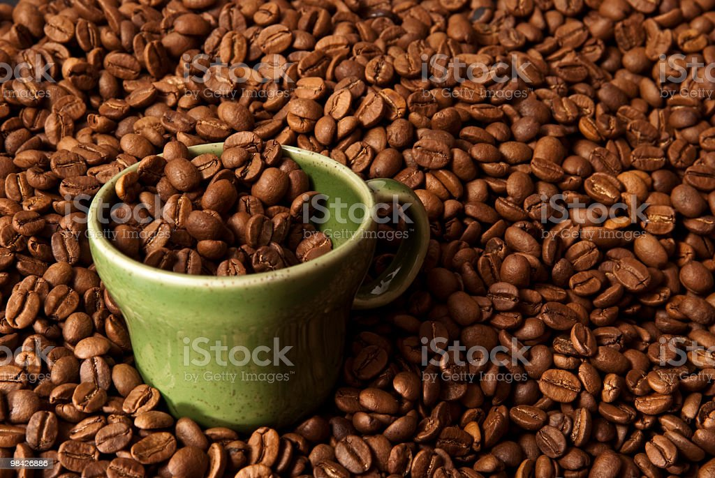 Coffee Beans and a Cup royalty-free stock photo