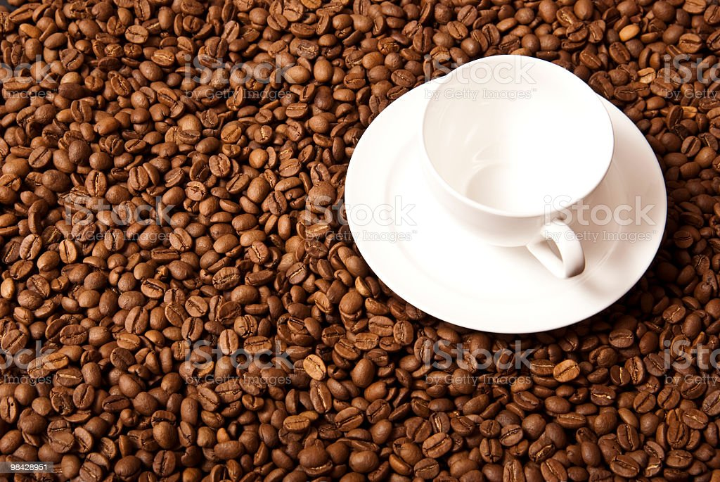 Coffee Beans and a white empty cup royalty-free stock photo
