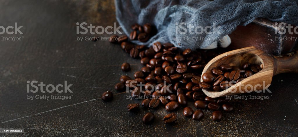 Coffee beans and a wooden spoon  on a dark background - Royalty-free Arabica Coffee - Crop Stock Photo