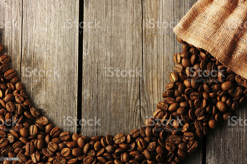 Coffee beans and bag background royalty-free stock photo