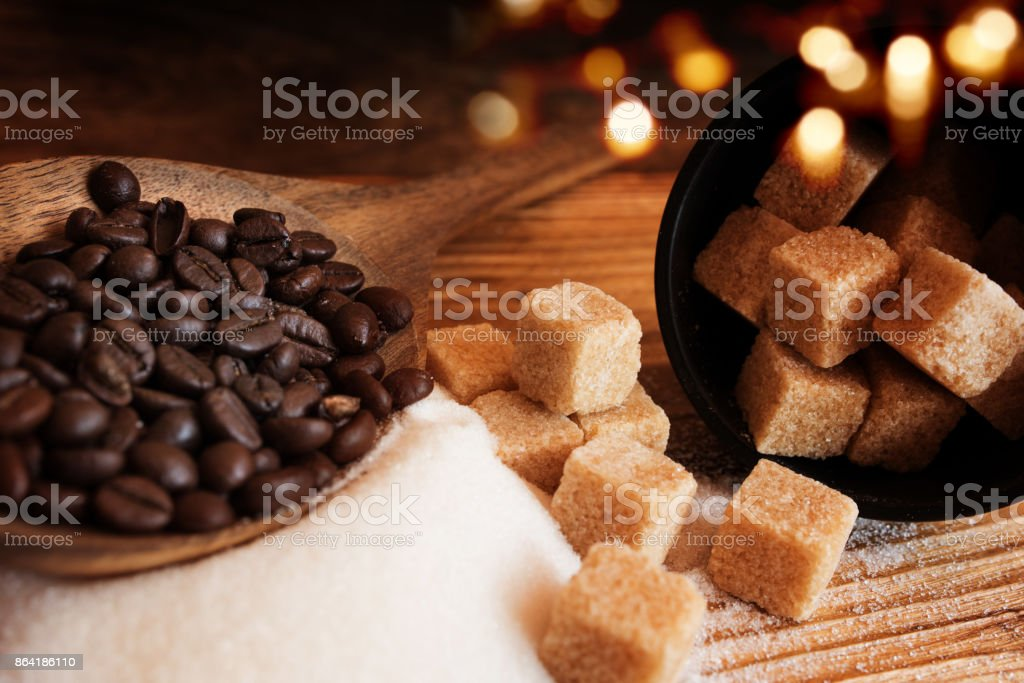 Coffee beans and brown sugar royalty-free stock photo