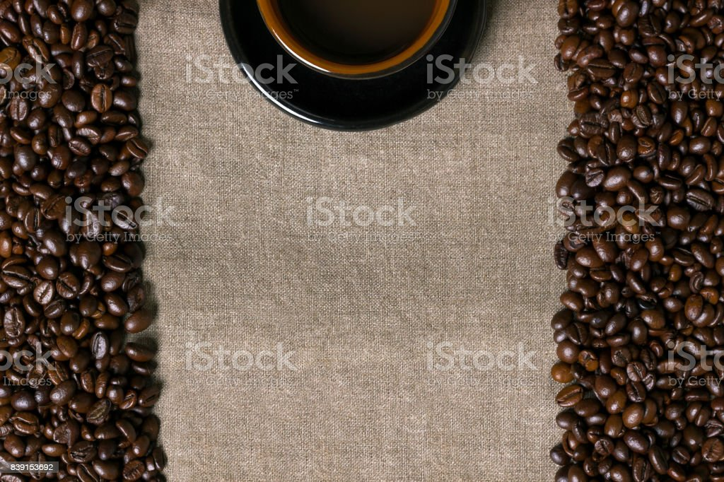 Coffee beans and Coffee cup on a burlap background stock photo