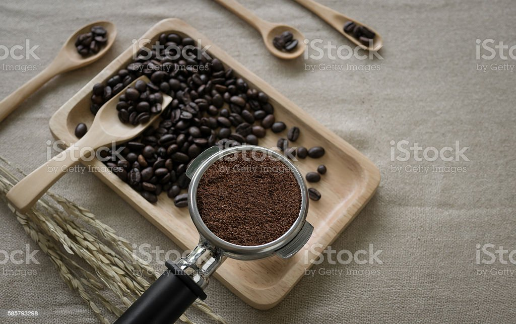coffee beans and coffee maker prepared on the desktop stock photo