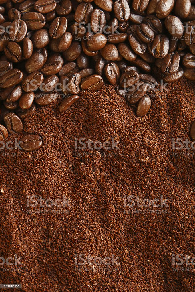 coffee beans and ground background, warm light stock photo