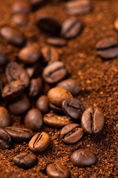 Coffee beans and ground coffee background