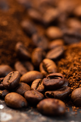Coffee Beans And Ground Coffee Background Stock Photo - Download Image Now