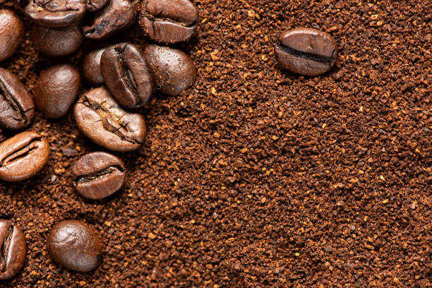 Coffee beans and ground coffee background stock photo