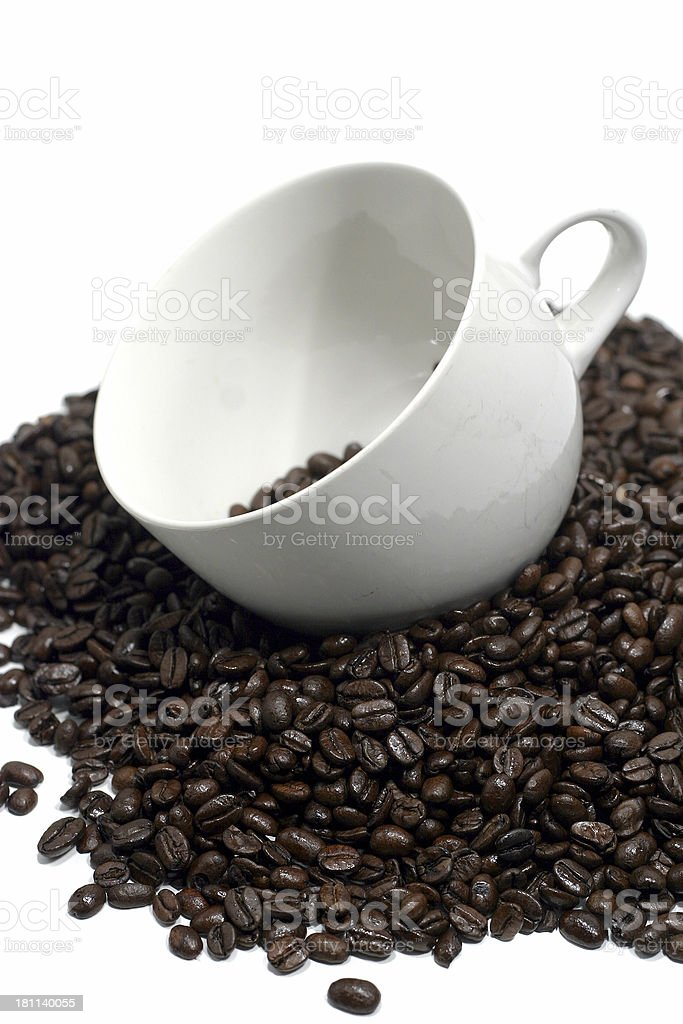 Coffee beans and mug royalty-free stock photo