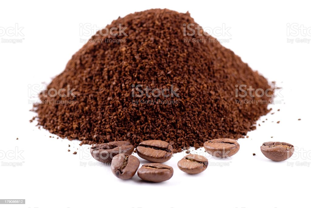 Coffee beans and powder on white background stock photo