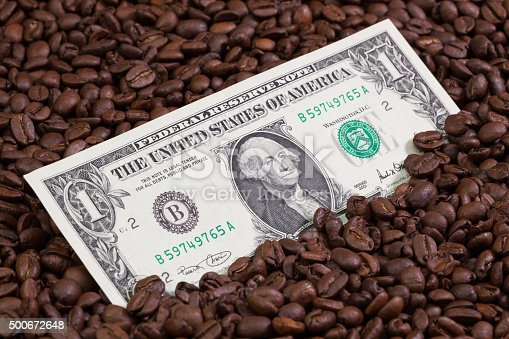 istock Coffee beans and US banknote 500672648