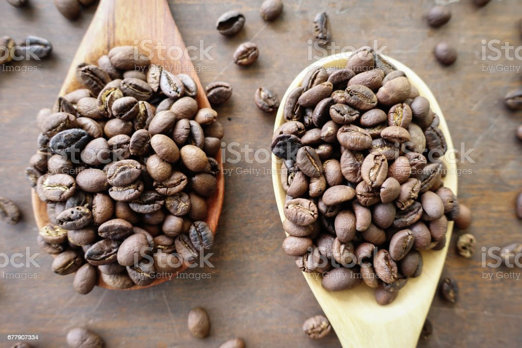 coffee beans and wooden spoon royalty-free stock photo