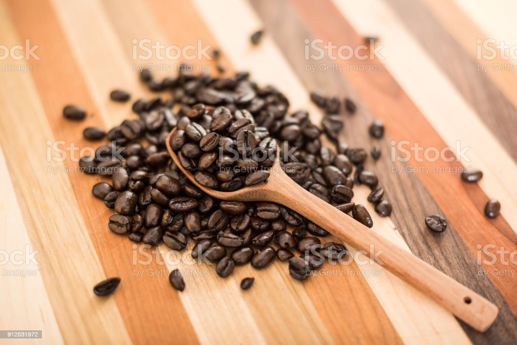 Coffee Beans and wooden spoon stock photo