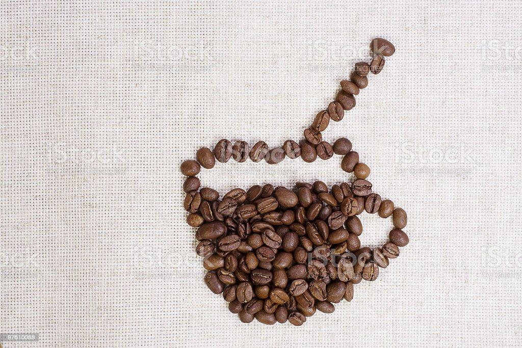 Grains de café dans une tasse photo libre de droits