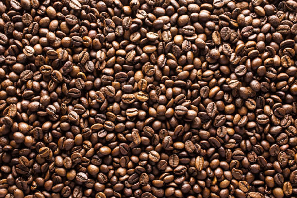 Coffee beans background coffee, beans, background coffee crop stock pictures, royalty-free photos & images