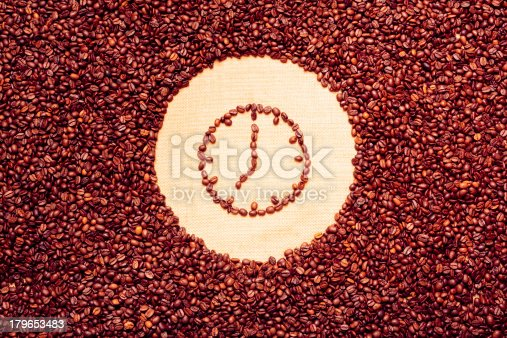 coffee beans background with alarm clock. good morning!