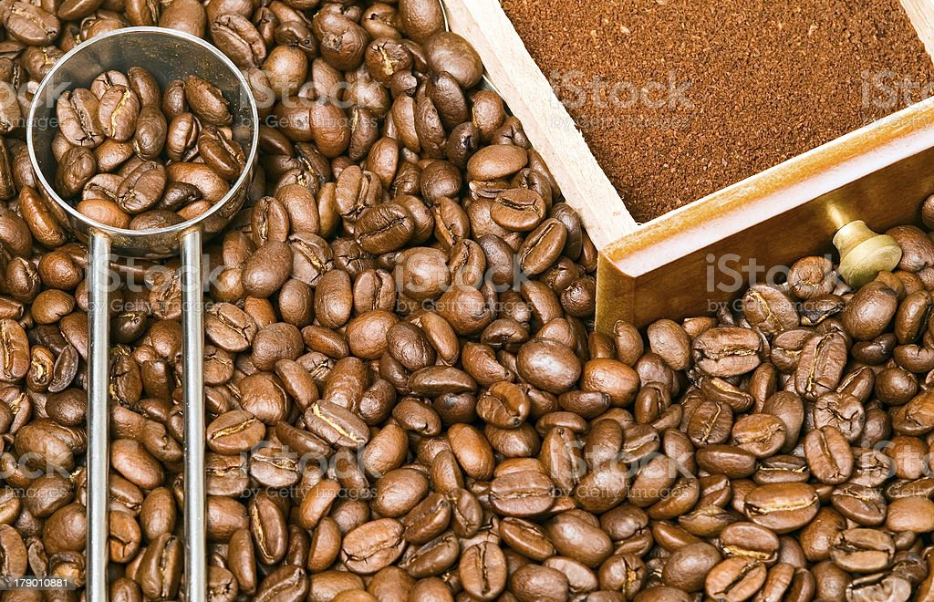 Coffee beans background with spoon and box royalty-free stock photo