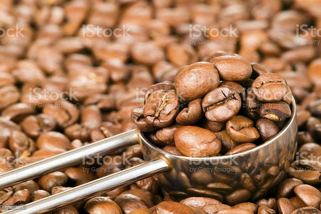 Coffee beans background with spoon royalty-free stock photo