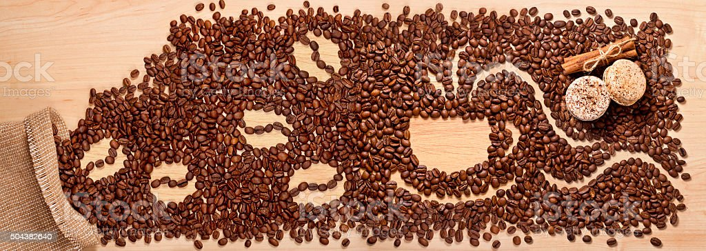 coffee beans, cinnamon and macaroons stock photo