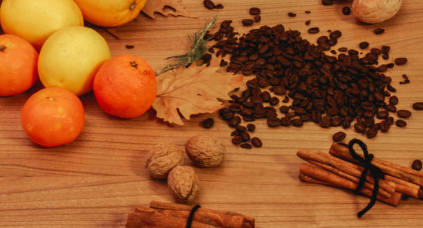 coffee beans, citrus, cinnamon sticks and dry nuts stock photo