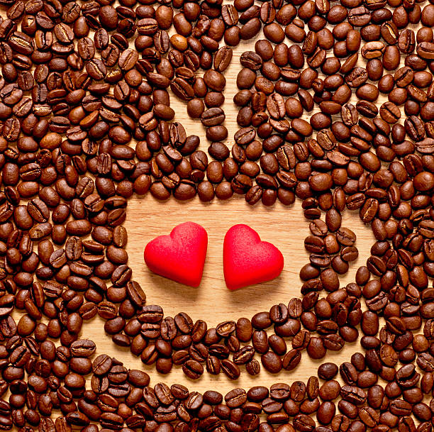 coffee beans cup and two heart stock photo