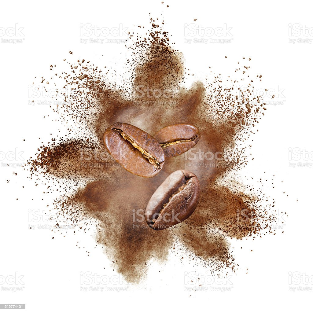 Coffee beans explosion isolated on white stock photo