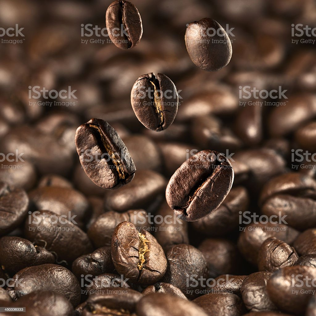 Coffee beans falling royalty-free stock photo