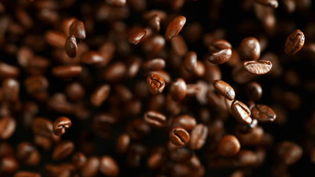 Coffee beans flying in the air, macro photo stock photo