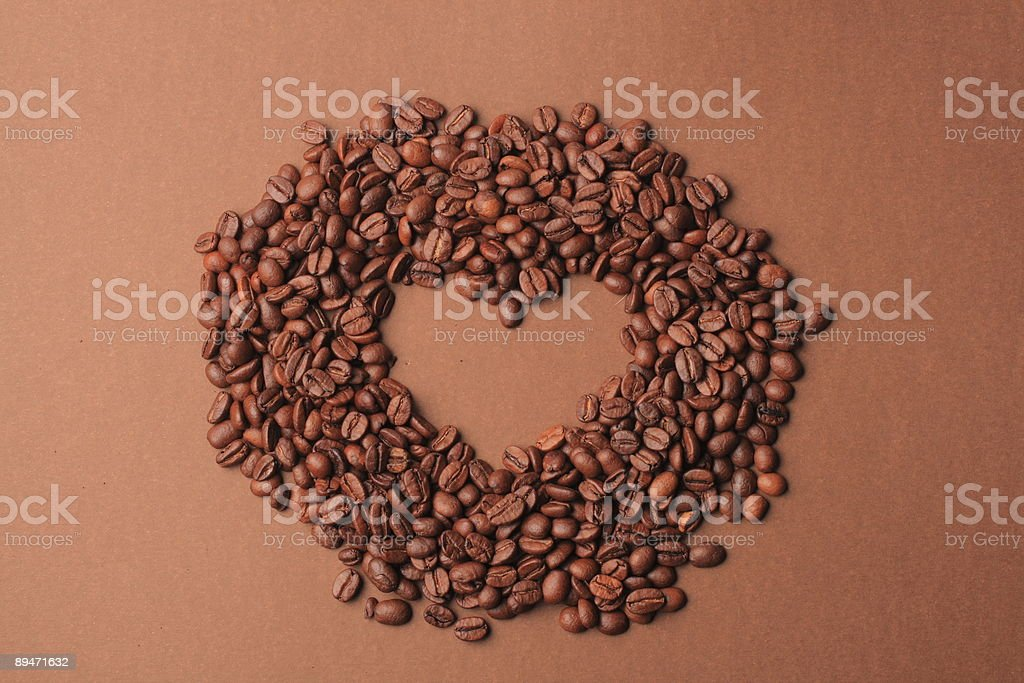 Coffee beans heart over brown background royalty-free stock photo