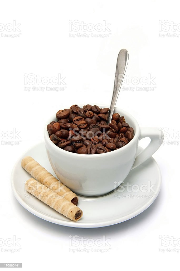 Coffee beans in a cup and candy royalty-free stock photo