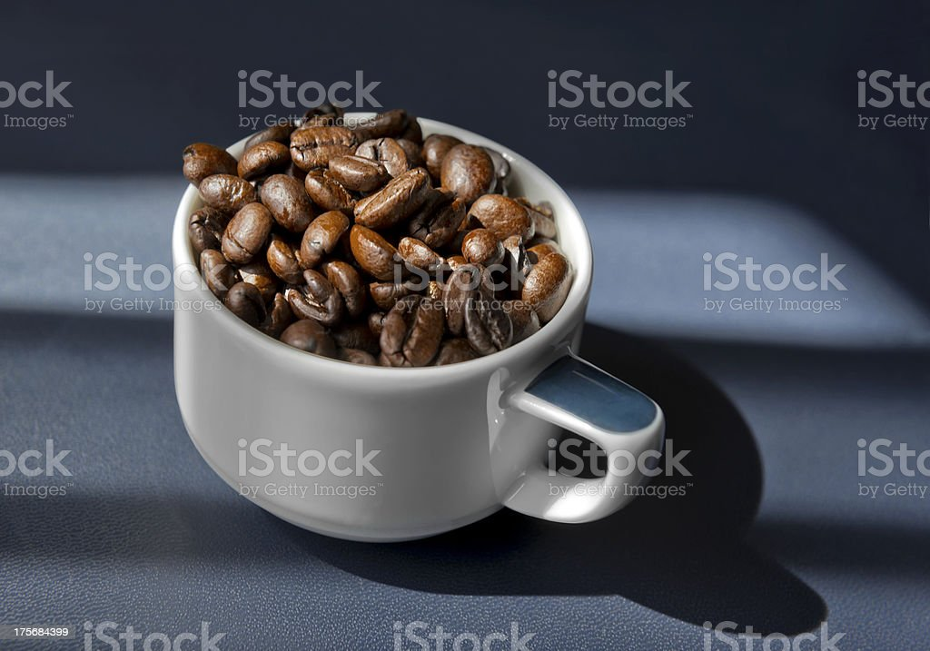 Coffee Beans in a Cup royalty-free stock photo