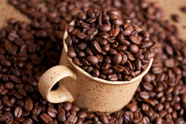 Coffee beans in a cup stock photo