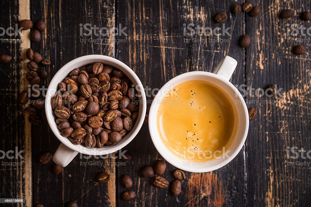 Coffee beans in a cups stock photo