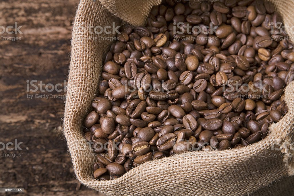 Coffee beans in a jute bag royalty-free stock photo