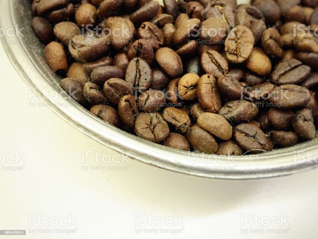 coffee beans in a metal bowl zbiór zdjęć royalty-free