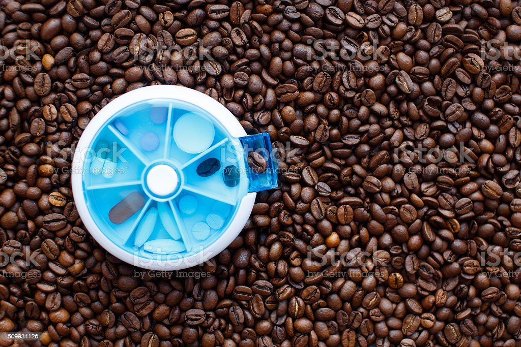 coffee beans in a pillbox stock photo