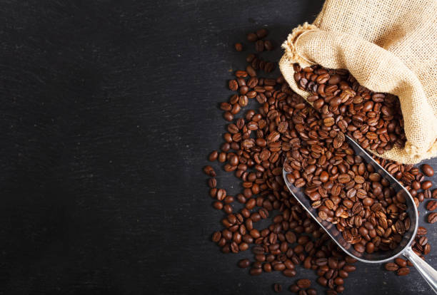coffee beans in a sack, top view stock photo