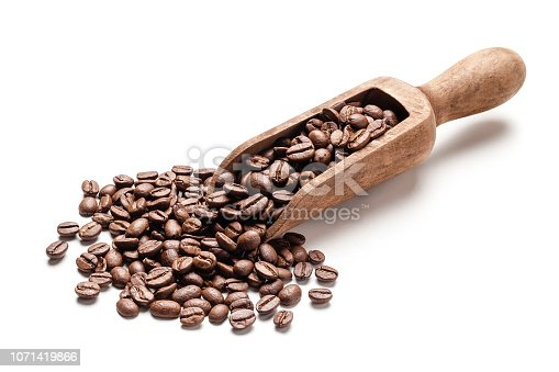 Close up view of a wooden serving scoop filled with roasted coffee beans isolated on white background. Predominant colors are brown and white. High key DSRL studio photo taken with Canon EOS 5D Mk II and Canon EF 100mm f/2.8L Macro IS USM.