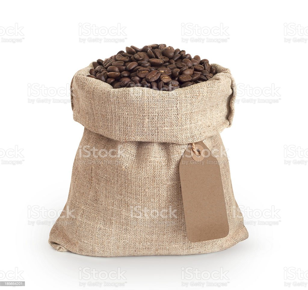 Coffee beans in burlap sack stock photo