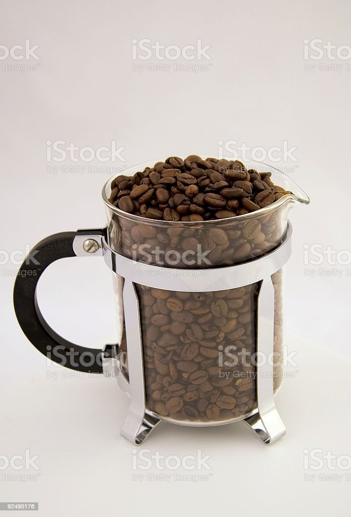 Coffee Beans in Glass Carafe for a French Press royalty-free stock photo