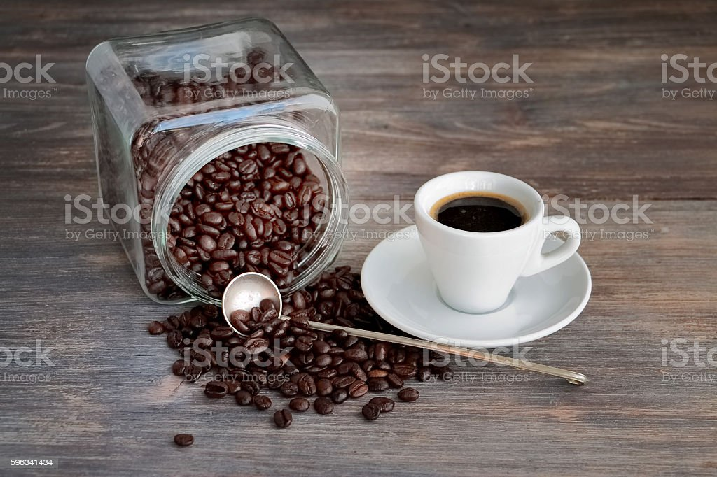 Coffee beans in glass jar and espresso cup royalty-free stock photo