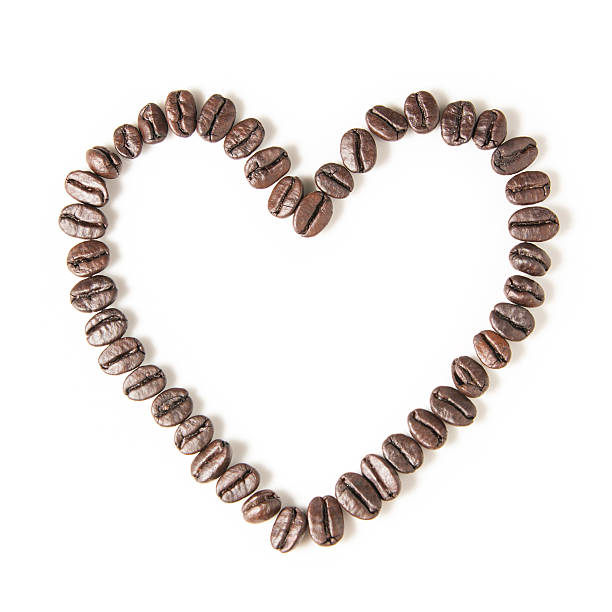 Coffee Beans in Heart Shape on White Background stock photo