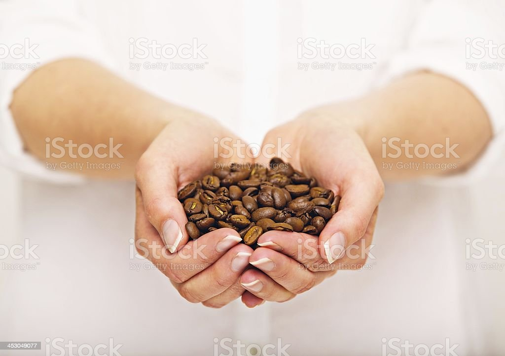 Coffee Beans in Her Hand royalty-free stock photo
