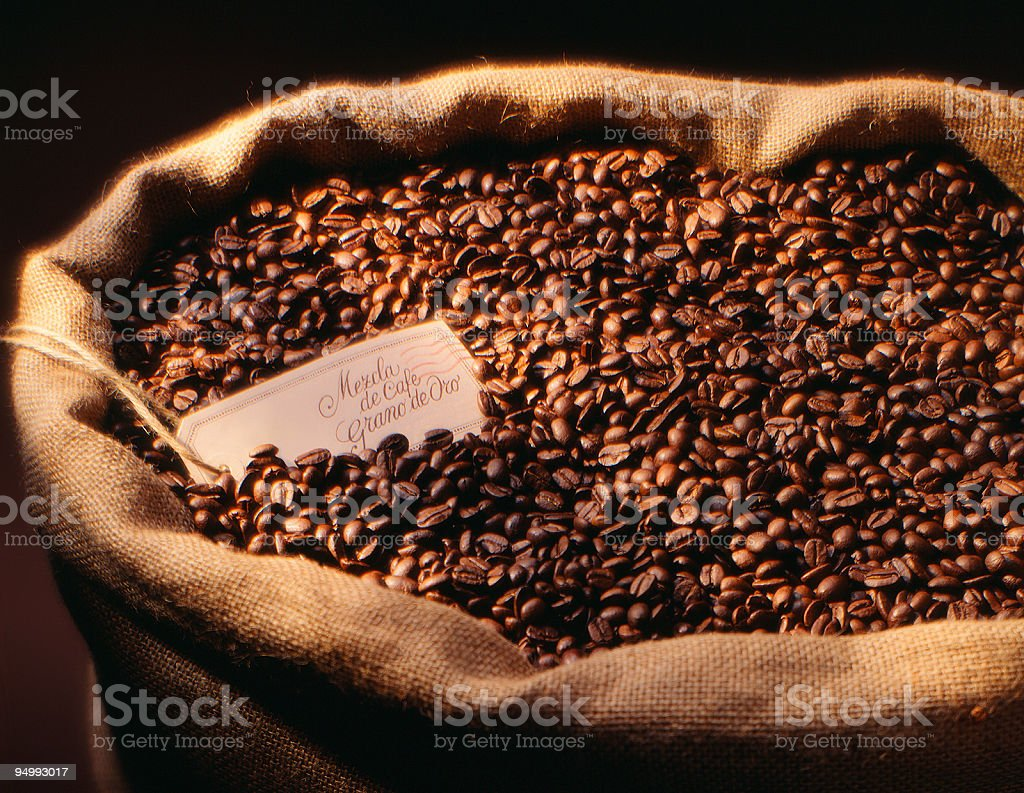 Coffee beans in large jute sack, close up royalty-free stock photo