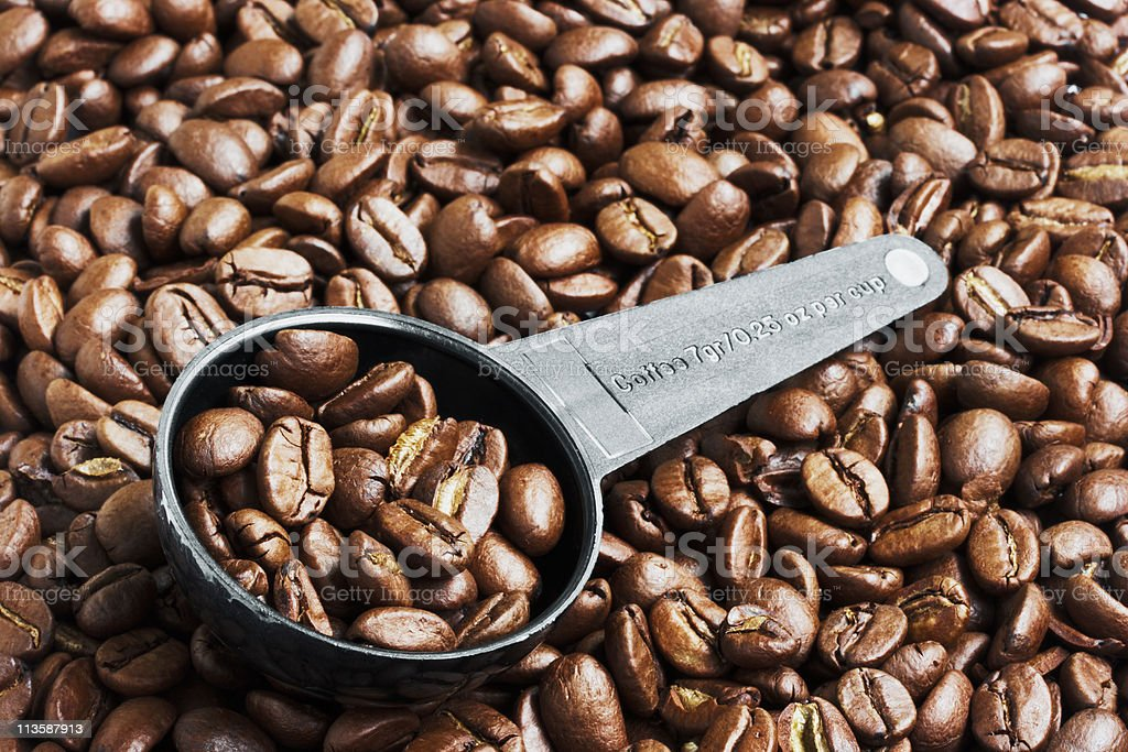 Coffee Beans in Measurement Spoon stock photo