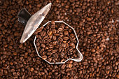 coffee beans in mocha pot with copy space