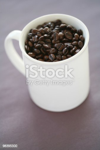 Coffee Beans In Mug Stock Photo & More Pictures of Caffeine