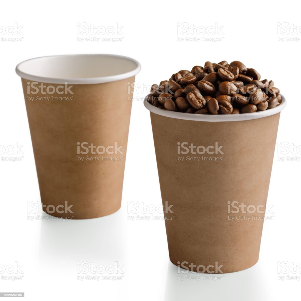 Coffee beans in paper cup isolated on white foto de stock libre de derechos