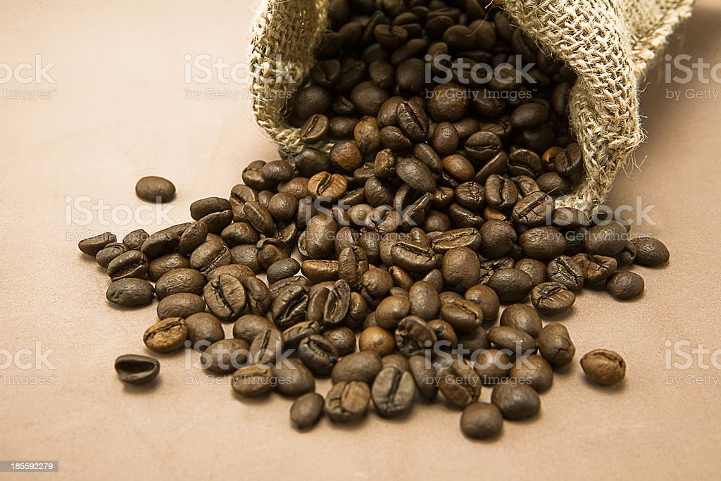 Coffee beans in sack, burlap background royalty-free stock photo