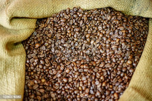 istock Coffee Beans in Sack 1036378380